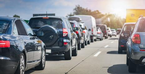 Car rush hours city street. Cars on highway in traffic jam