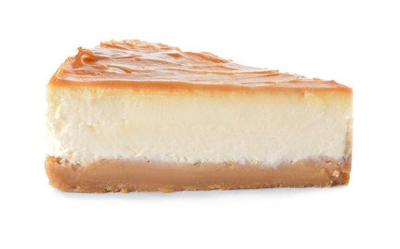 Slice of sweet caramel cheesecake on white background