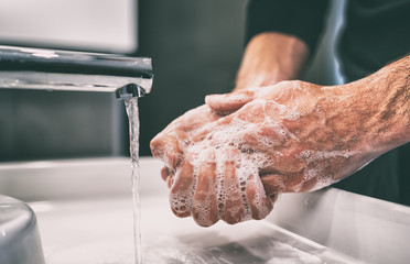 Coronavirus pandemic prevention wash hands with soap warm water and , rubbing nails and fingers...
