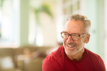 Mature handome fit man sitting outside stock photo Fotomurales