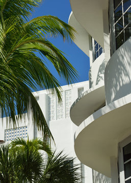 Architectural detail of concrete slab eaves on art deco buildings of South Beach, Miami, Florida. Wave mottifs, palm trees, tropical vibes, 1930s architecture.