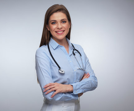 Portrait of smiling female medical worker with folded hands.