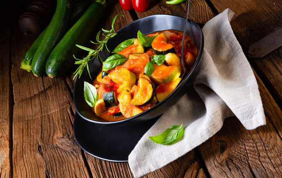 zucchini vegetarian ratatouille with tomato sauce and herbs