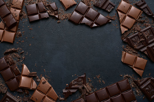 Slices of dark and milk chocolate. Top view with copy space.