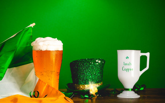St Patricks day party celebration concept with glass of beer and Irish coffee over a green background.
