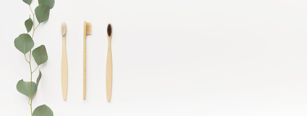 Bamboo toothbrushes for family isolated on white
