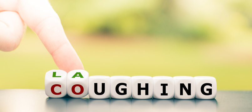 """Laughter is the best medicine. Hand turns dice and changes the word """"coughing"""" to """"laughing""""."""