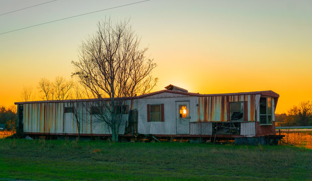 Traditional American Mobile Home Abandon Poverty In Country At Sunset