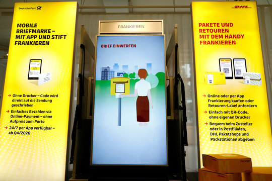 An oversized display shows the functions of automated and internet connected package delivery station with ability to receive payments by app, in Berlin
