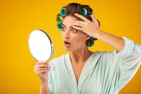 Housewife Stressing About Wrinkles Looking In Mirror On Yellow Background