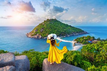 Wall Mural - Beautiful girl standing on viewpoint at Koh Nangyuan island near Koh Tao island, Surat Thaini in Thailand.