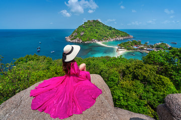 Wall Mural - Beautiful girl sitting on viewpoint at Koh Nangyuan island near Koh Tao island, Surat Thaini in Thailand.