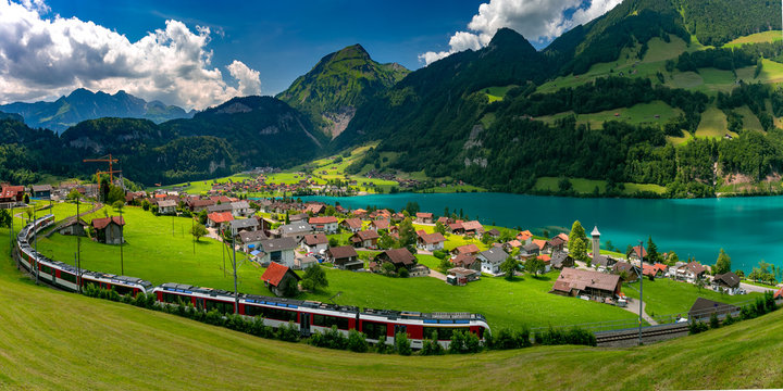 Famous electric red tourist panoramic train in swiss village Lungern, canton of Obwalden, Switzerland
