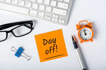 Day off - message on office workplace. Out of office concept