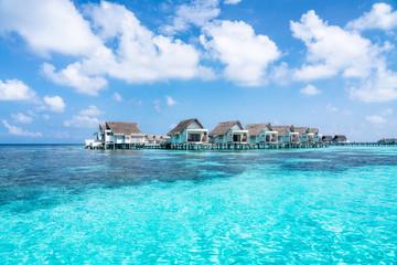 Overwater villas in the blue lagoon