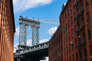 Acrylic Prints Narrow alley The Manhattan Bridge between Old Red Brick Buildings in Dumbo Brooklyn New York