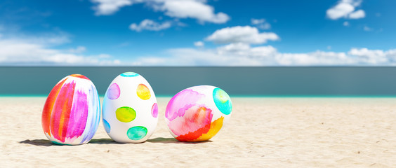 beach with colorful easter eggs during a easter vacation at the beach Fototapete
