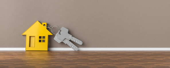 Panorama of keys with yellow house leaning on wall as mortgage financing concept, copyspace for your individual text.