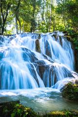 Fotobehang Watervallen Agua Azul means