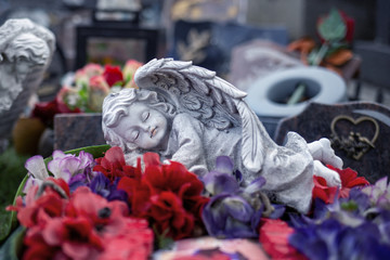 sleeping stoned angel at cemetery,grave angel statue Fototapete