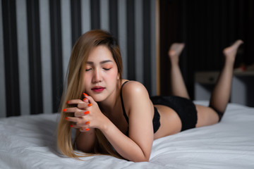 Portrait of asian sexy woman on the bed,Thailand people wear bra for take a picture