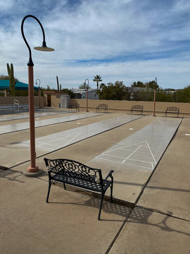 Empty shuffleboard court with benches in Arizona on beautiful day
