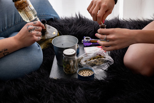 Two People Using Recreational Cannabis with User Paraphernalia