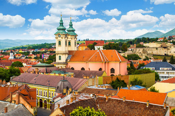 Fotobehang Oude gebouw Panoramic view of old town of Eger (Hungary) from the Eszterhazy University. Church of Anthony of Padua, Castle of Eger.