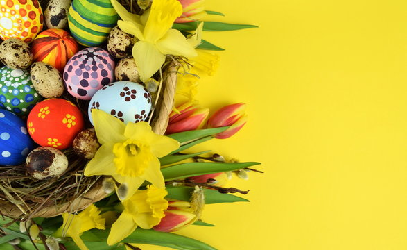Happy Easter - painted eggs on colored background
