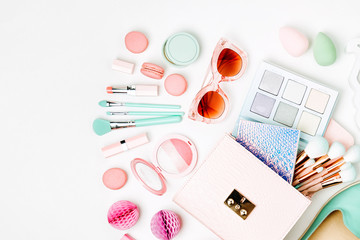 Wall Mural - Flat lay of female fashion accessories, shoes, makeup products and handbag on pastel color background. Beauty and fashion concept