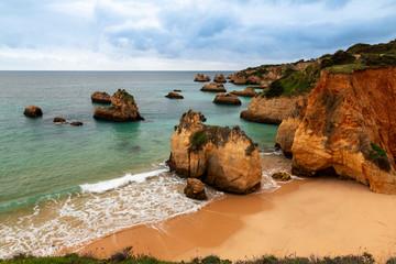 Scenic view of the beautiful Praia do Alemao and the Ponta Joao de Arens in Portimao, Algarve, Portugal