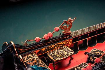 Foto op Aluminium Gondolas gondola interior of red and gold on a venice canal