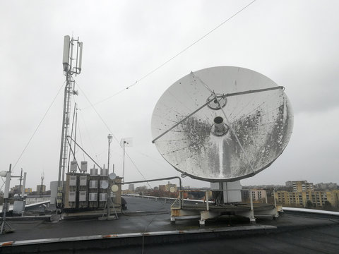 Satellite parabolic dish antenna on the roof for high speed internet link