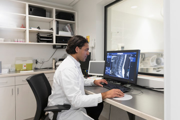 Radiology technologist in MRI computer room