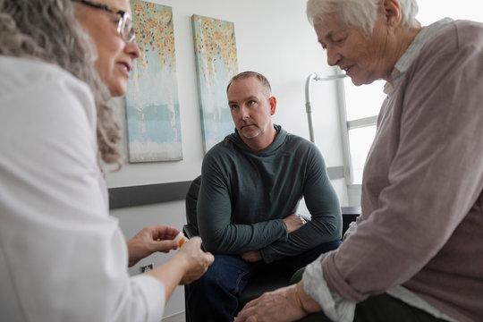 Doctor explaining medication to senior woman