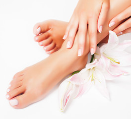 Photo sur cadre textile Pedicure manicure pedicure with flower lily closeup isolated on white perfect shape hands spa salon