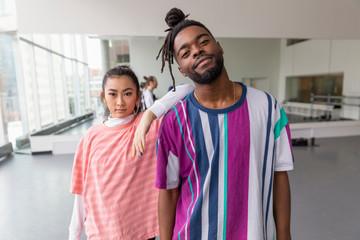 Portrait confident cool young hip-hop dancers in dance studio