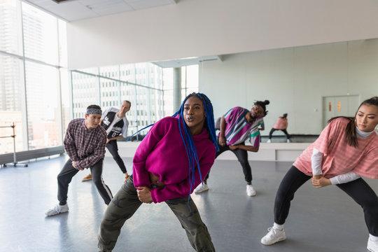 Young hip-hop dancers rehearsing in dance studio