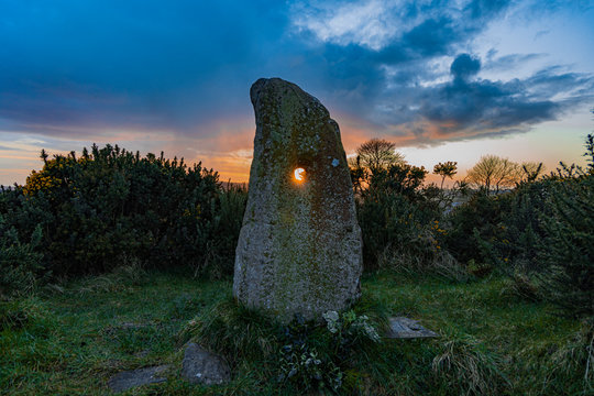The Holestone, ancient Bronze age standing stone that sits atop a small rocky outcrop outside Doagh, County Antrim, Northern Ireland