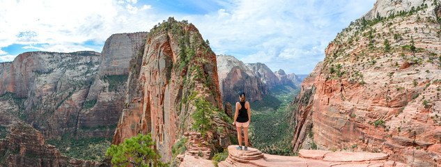 sportive woman at angels landing trail in zion national park