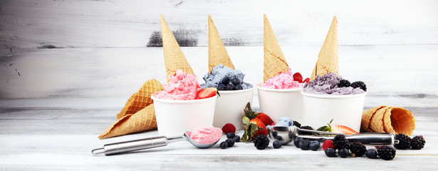 Various of ice cream flavors blueberry, strawberry, blackberry setup on rustic background . Summer and Sweet berries ice concept. Wall mural