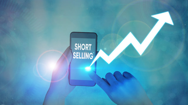 Conceptual hand writing showing Short Selling. Concept meaning Act of selling an asset that you do not currently own