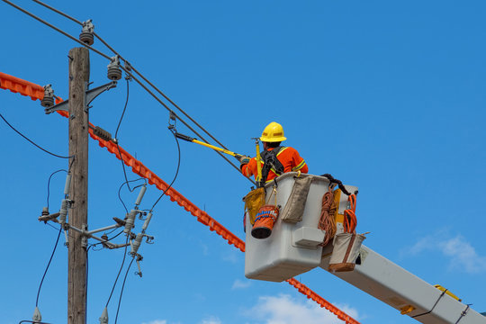 Contractor at work fixing electric lines
