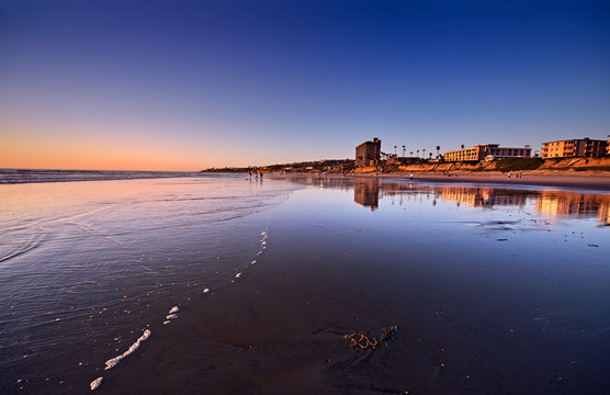 A sunset warmth lights up the oceanfront in Pacific Beach, on a clear Winter evening