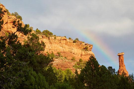 Rainbow over ancient red rock formation near Sedona in the Arizona desert