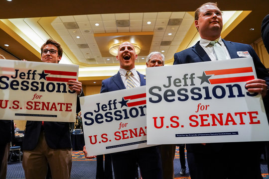 Supporters react as former U.S. Attorney General and Republican senate candidate Jeff Sessions speaks in Mobile