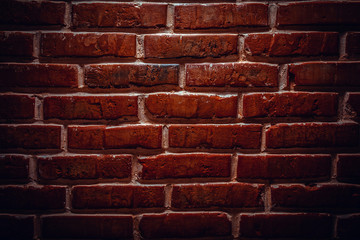 Dark old polished brick wall texture. Background image