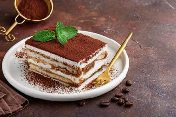Fototapeta Traditional italian dessert tiramisu on a white plate. Copy space. Selective focus obraz