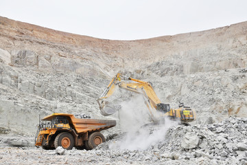 An excavator driven by Rosalie Guirou Kulga, 30, clears out rocks into a dumper at the gold mine, operated by Endeavour Mining Corporation in Hounde