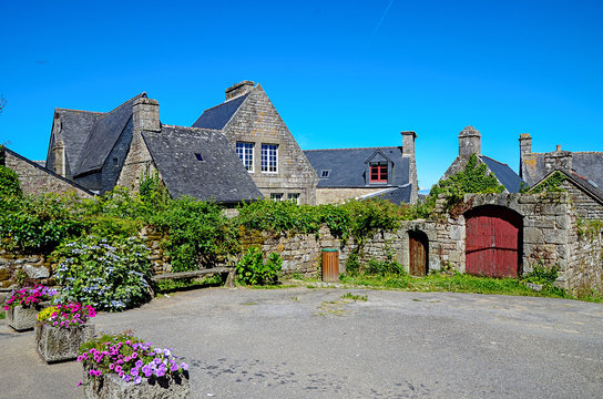 Locronan, France - July 15, 2016: Medieval streets of Locronan, a small town in Brittany, France. It is one of the most beautiful villages in France